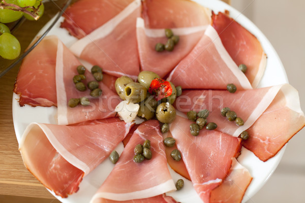 Prosciutto with olives and caper Stock photo © wjarek