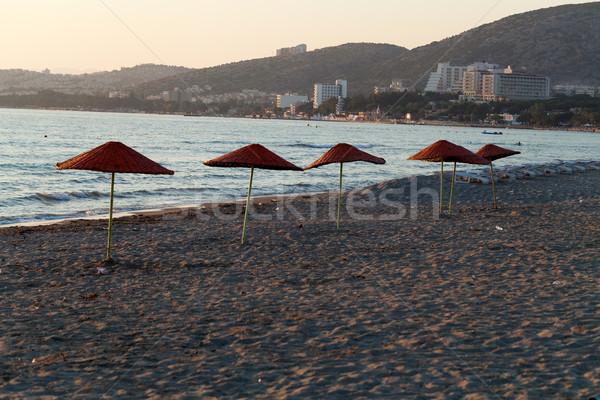 Parasols strand hemel zee zomer zonsopgang Stockfoto © wjarek