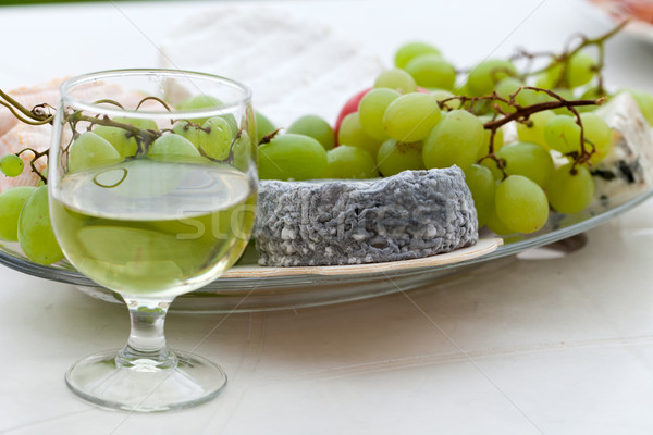 Various sorts of cheese, grapes and glass of the white wine Stock photo © wjarek