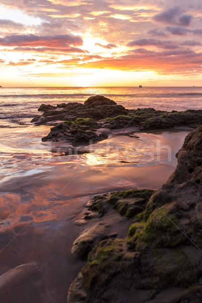 Naplemente tengerpart színes hullámok nedves homok Stock fotó © wollertz