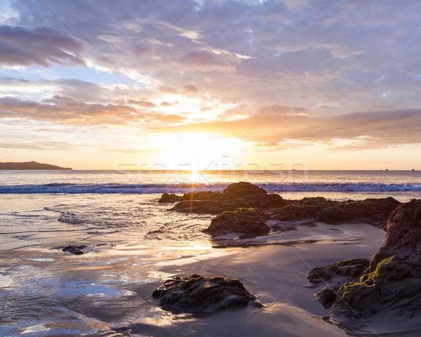 Stock fotó: Naplemente · tengerpart · színes · hullámok · nedves · homok