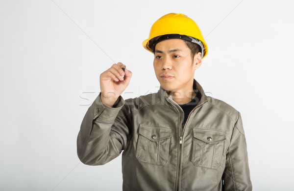 construction worker writing notes Stock photo © wxin