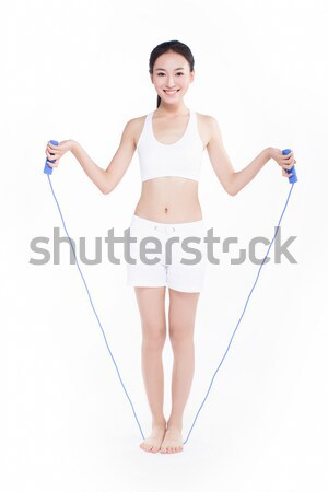smiling woman with a bathroom scale Stock photo © wxin