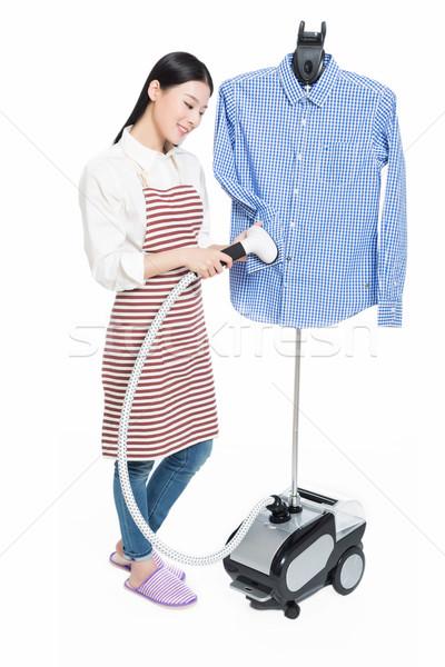 Jovem dona de casa isolado branco mulher Foto stock © wxin
