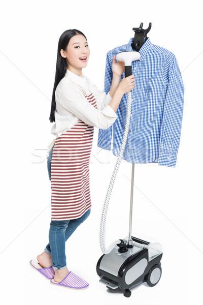 Fiatal háziasszony vasalás izolált fehér nő Stock fotó © wxin