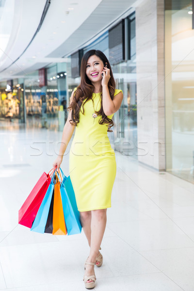 young woman shopping phoning in mall Stock photo © wxin