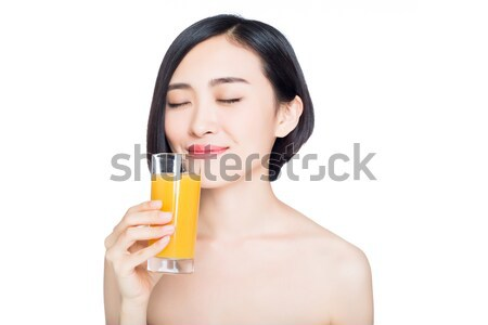 young woman with orange juice, white background Stock photo © wxin