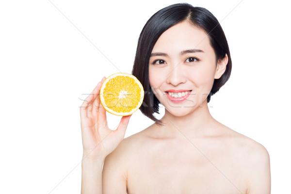 Chinese vrouw sinaasappelen handen jonge vrouw witte Stockfoto © wxin