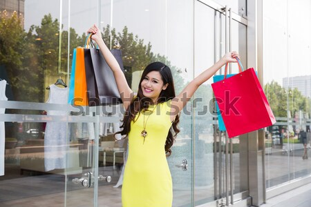excited shopping woman Stock photo © wxin