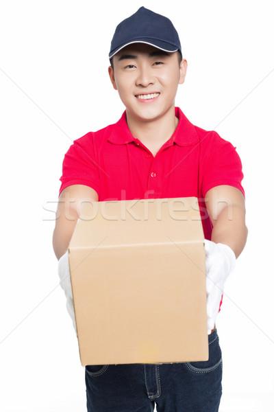 Futár hordoz kartondoboz fehér mosoly doboz Stock fotó © wxin