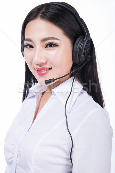 ügyfélszolgálat callcenter képviselő fekete haj lány fejhallgató Stock fotó © wxin