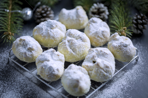 Walnuts Cookie sprinkled with powdered Sugar on Black Table with Stock photo © x3mwoman