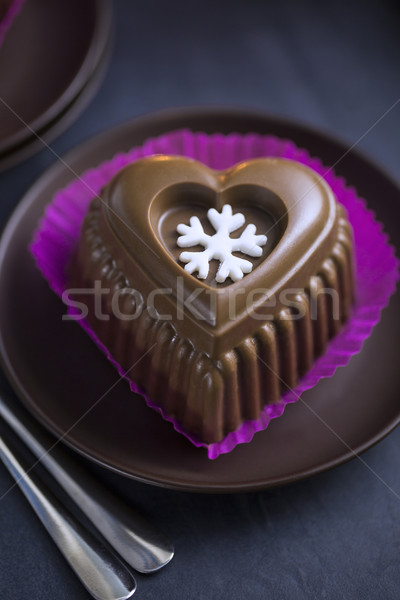 Chocolate Heart Cake with White Snowflake for New Year's Eve Stock photo © x3mwoman