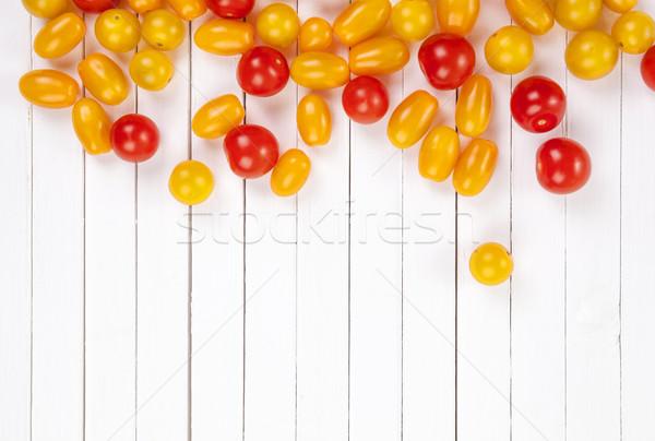Tomatoes on white background, top view. Stock photo © xamtiw