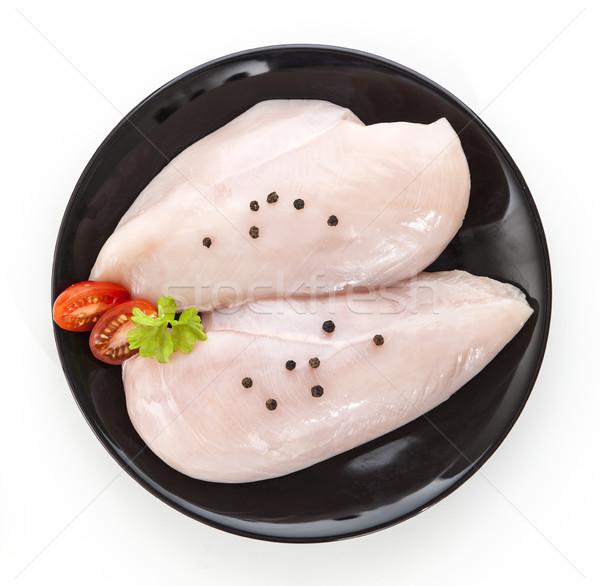 raw chicken fillet on a black plate Stock photo © xamtiw