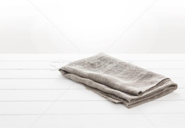 Kitchen towel on white wooden table Stock photo © xamtiw