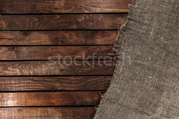 Burlap texture on wooden table background Stock photo © xamtiw