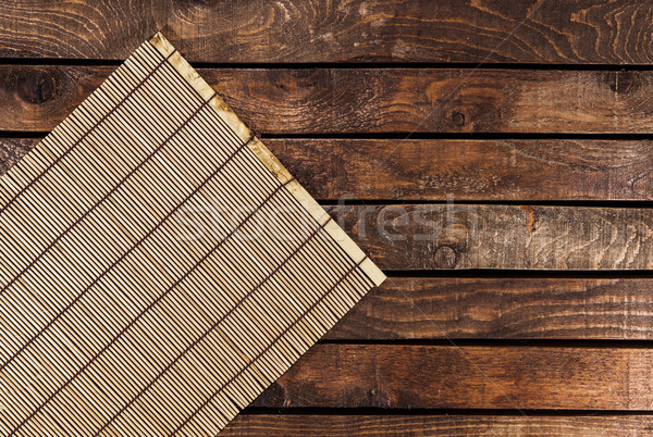 Bamboo mat on wooden table Stock photo © xamtiw