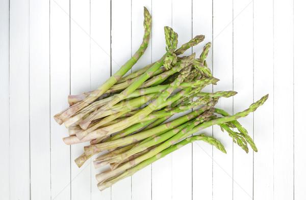 Fresh asparagus on white wooden table background. Top view Stock photo © xamtiw
