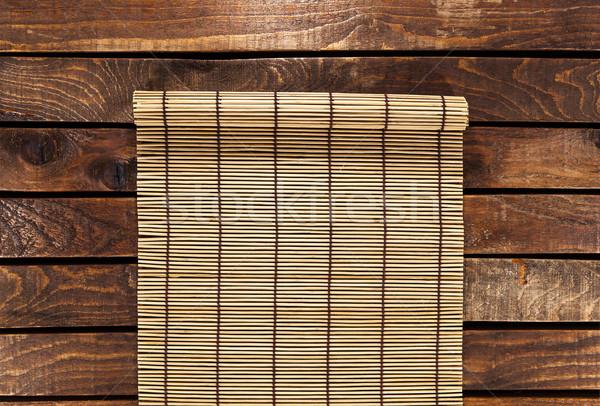 bamboo mat on wooden table. top view Stock photo © xamtiw