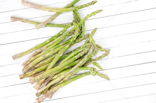 Fresh green asparagus on white wooden table. Top view Stock photo © xamtiw