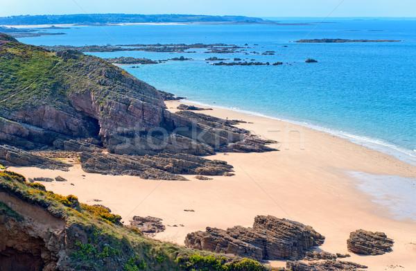 Homok tengerpart Franciaország sötét kövek part Stock fotó © Xantana