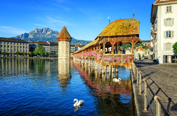 Wooden Chapel Bridge and Water Tower int Lucerne, Switzerland Stock photo © Xantana