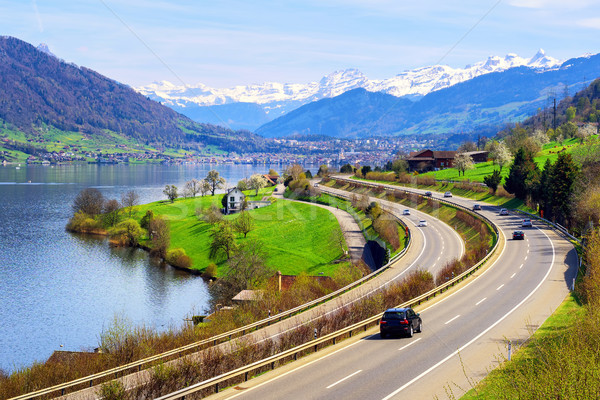 Swiss landscape with a highway, lake and mountains Stock photo © Xantana