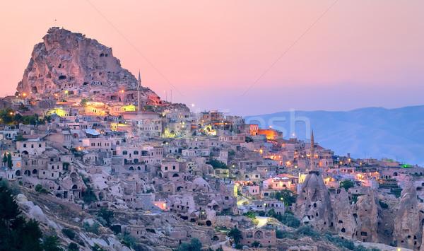 Uchisar cave city in Cappadocia, Turkey on sunset Stock photo © Xantana
