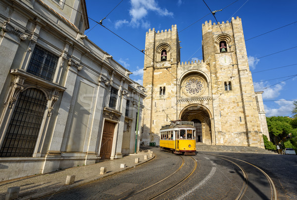 Old tram in front of cathedral in Lisbon, Portugal Stock photo © Xantana