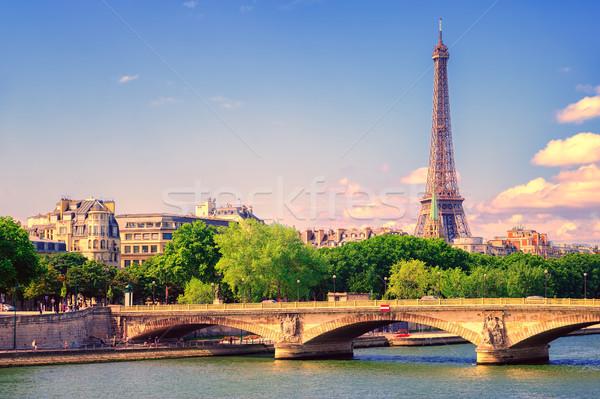 Eiffel torony emelkedő folyó naplemente épület Stock fotó © Xantana