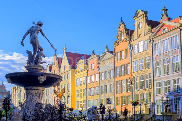 Neptune statue with colorful houses in background, Gdansk, Poland Stock photo © Xantana