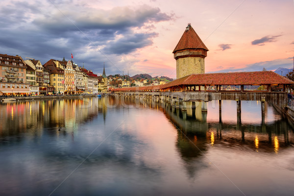 Wooden Chapel Bridge and Water Tower on sunset, Lucerne, Switzerland Stock photo © Xantana
