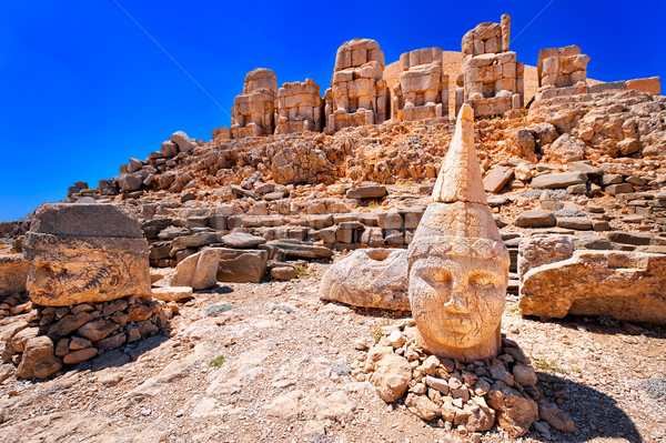 Antique statues on the top of Nemrut mountain at sunrise, Turkey Stock photo © Xantana