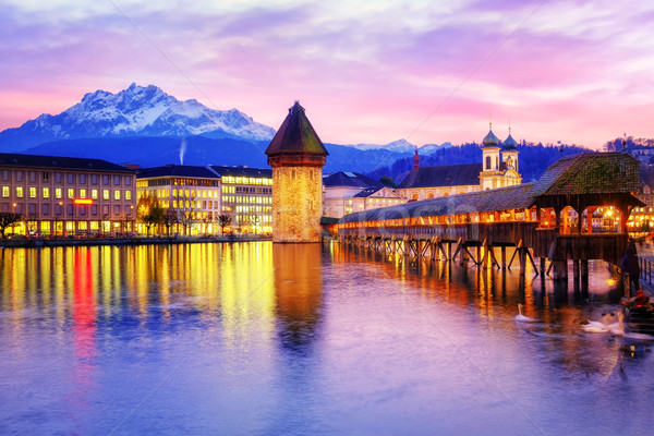 Chapel bridge and Old Town of Lucerne, Switzerland, on sunset Stock photo © Xantana