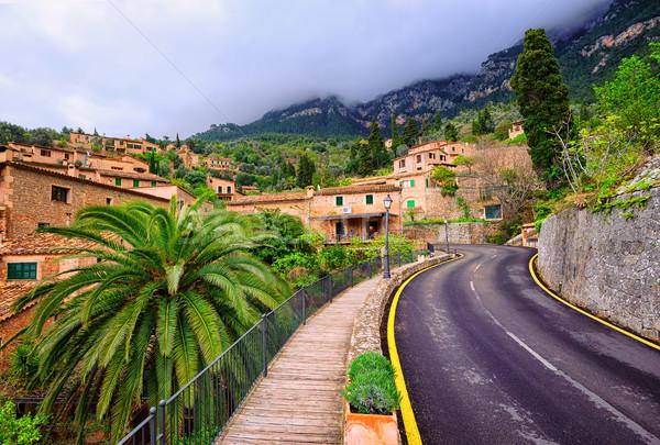 Mountain road winding through little spanish town, Spain Stock photo © Xantana