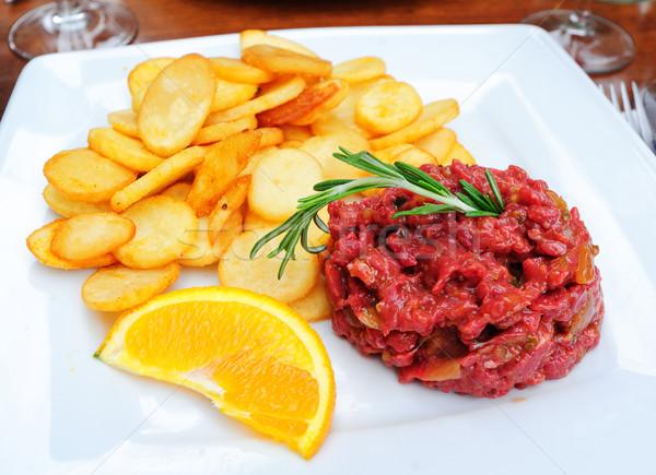 Steak tartare served with french fries potato chips Stock photo © Xantana