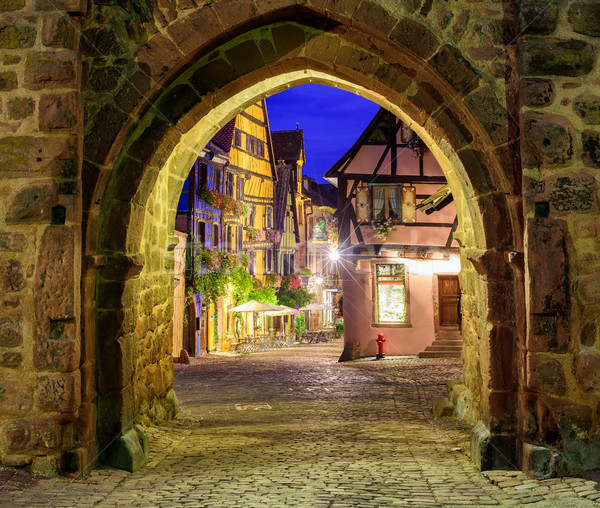 View of Riquewihr, Alsace, France, through city wall gate at nig Stock photo © Xantana