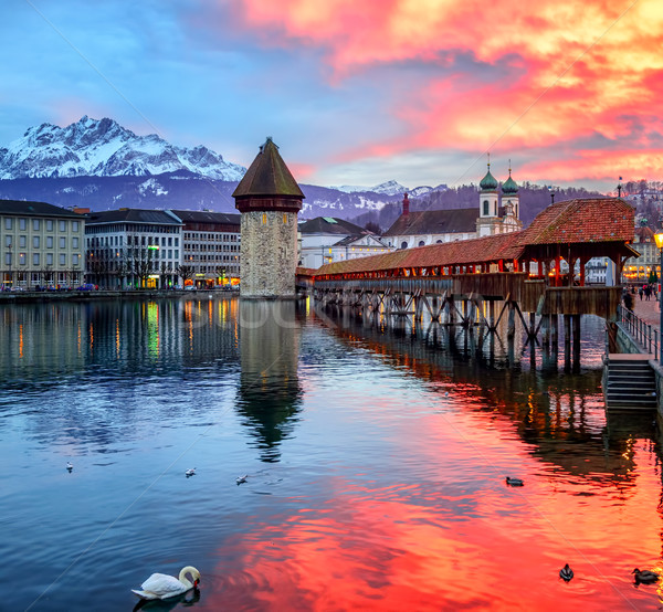 Dramatic sunset over the old town of Lucerne, Switzerland Stock photo © Xantana