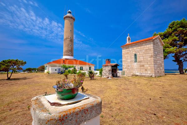 Rat phare chapelle vue île mer Photo stock © xbrchx