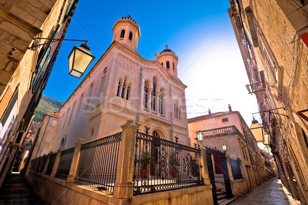 Stone narrow street of Dubrovnik church view Stock photo © xbrchx