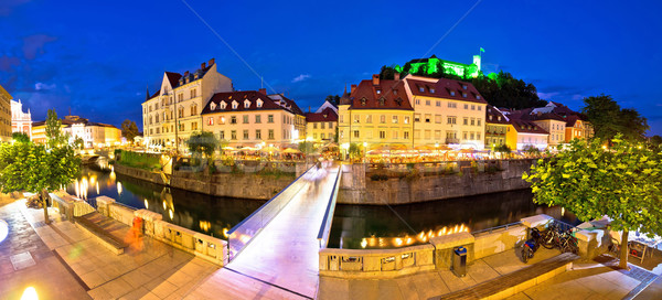 Evening panorama of Ljubljana river, architecture and castle Stock photo © xbrchx