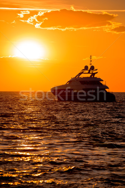 Luxe yacht ouvrir mer or coucher du soleil Photo stock © xbrchx