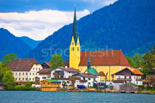 Idyllique lac village eau bâtiment paysage Photo stock © xbrchx