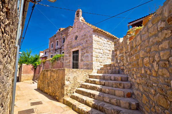 öreg kő keskeny utca kápolna város Stock fotó © xbrchx
