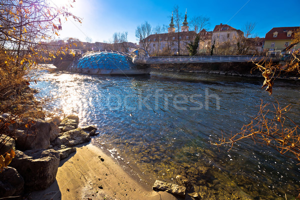 Mur river beach and Murinsel in Graz view Stock photo © xbrchx