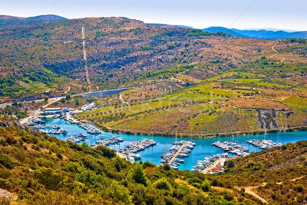 Marina in bay near Primosten aerial view Stock photo © xbrchx