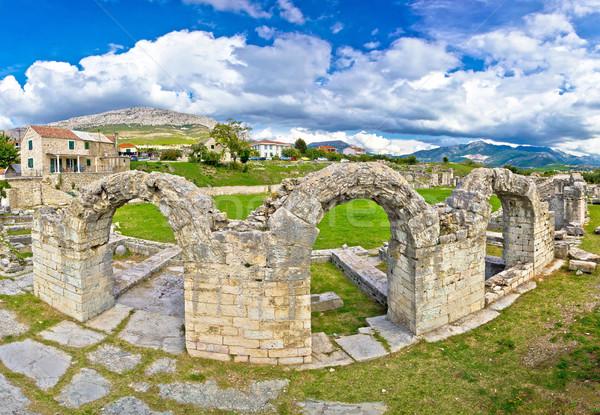 Historic stone amphitheatre in ancient Solin Stock photo © xbrchx