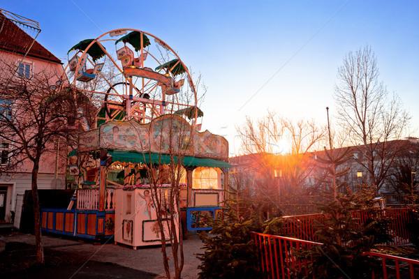 Graz Christmas fair ferris wheel sunset view Stock photo © xbrchx