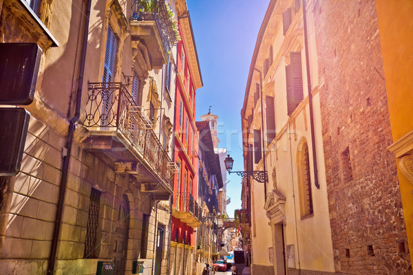 Colorful street of Verona in sun haze view Stock photo © xbrchx